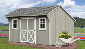 grey shed with sitting in front of fence and field