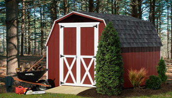 maroon shed with shrubbery out front