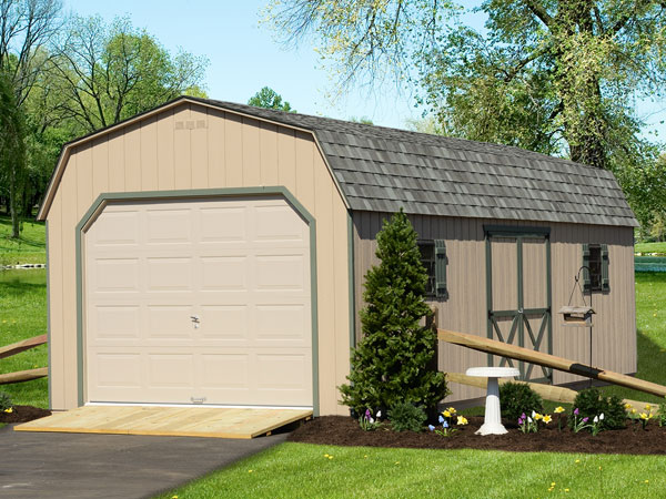 backyard man cave shed garage with driveway leading up to it
