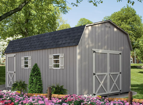 grey amish build she shed garage sitting behind flower bed