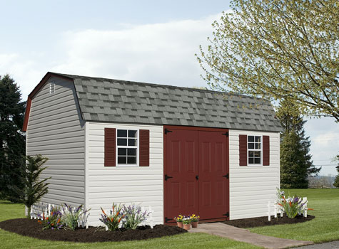 backyard she shed with maroon doors and asphalt shingles