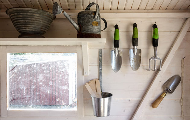 garden tools inside of amish built garden shed